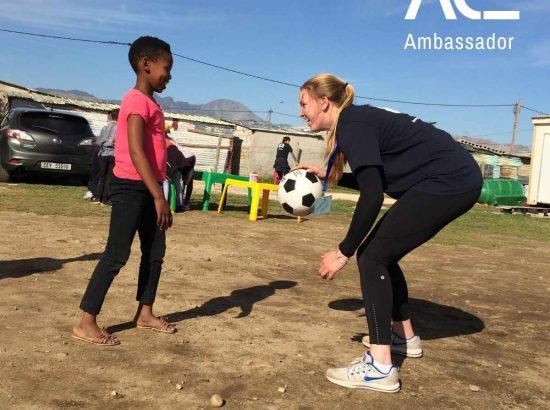 student and child playing softball