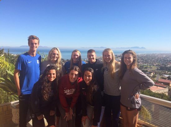 group of student-athletes by sea overlook