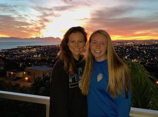 young females enjoying a sunset in Gordon's Bay
