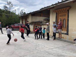 group of kids playing basketball outside