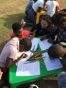 group of kids drawing outside