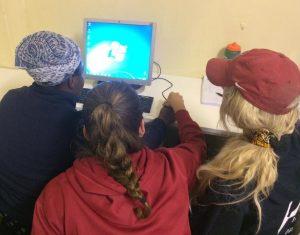 group of women around computer