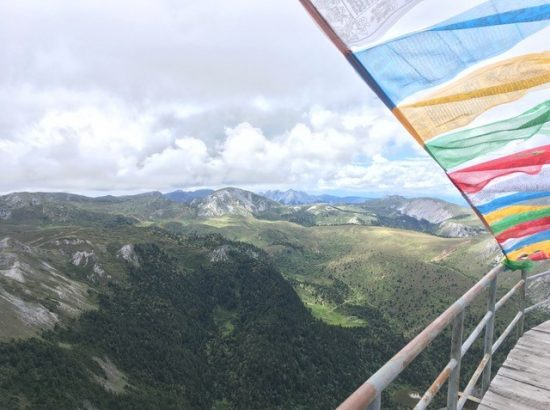 colorful prayer flag with mountain in the background