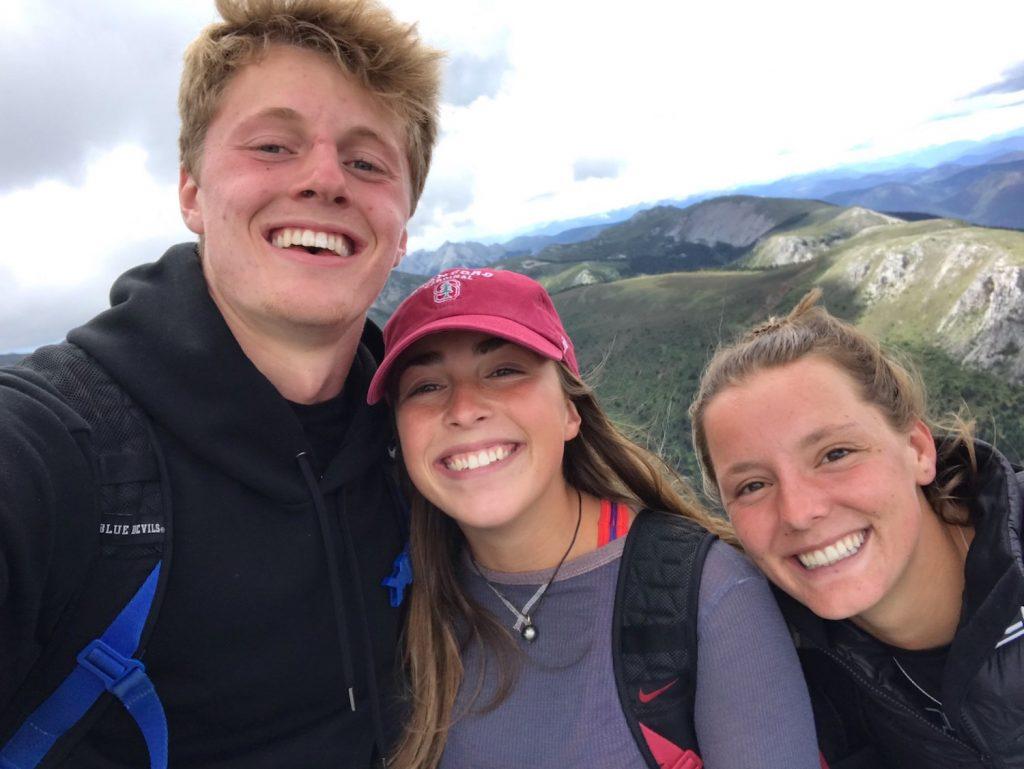 group selfie atop a mountain