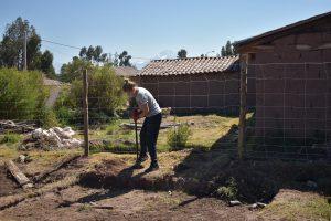 young woman shoveling mulch