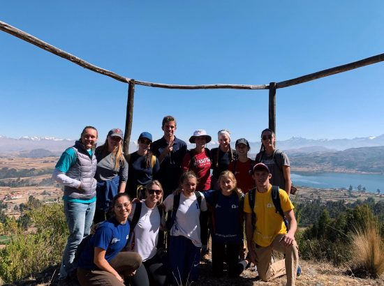 group of students with mountains behind