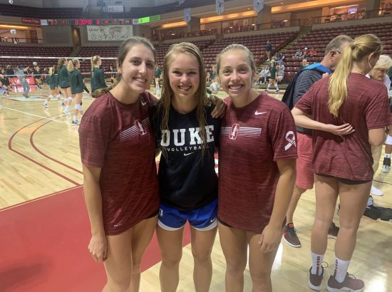 three women's volleyball players