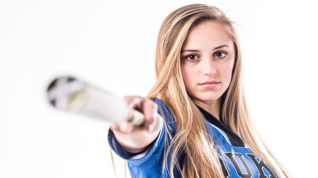 girl holidng a baseball bat