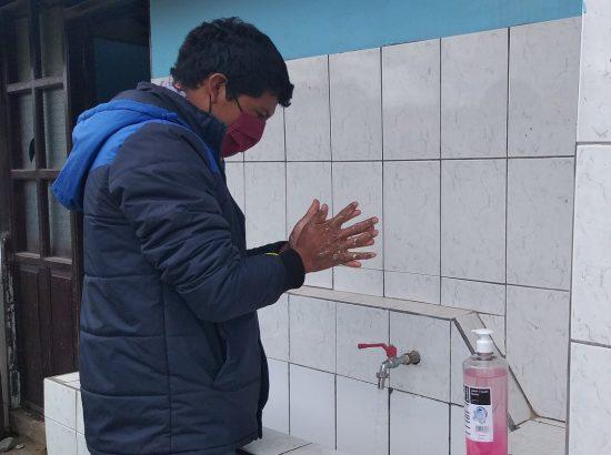 man sanitizing hands