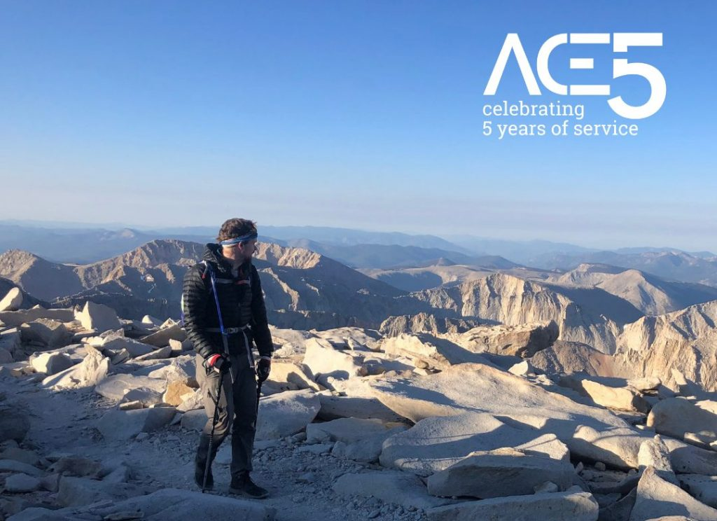 man hiking tall mountain