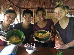 group of people posing bowls of food