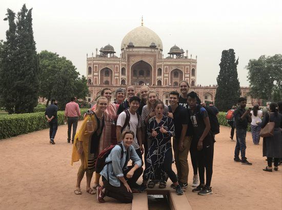 Group posing for photo in India