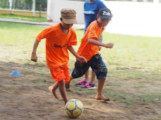 Kids playing soccer in Vietnam
