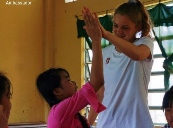 woman and little girl high-fiving