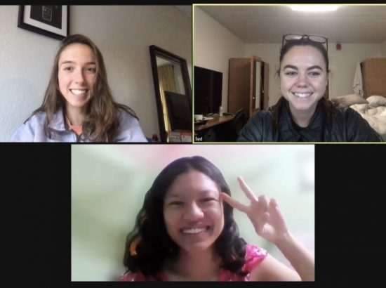 zoom screenshot women showing peace sign