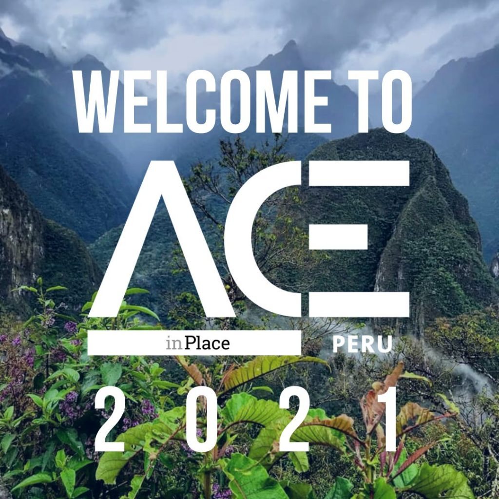 green mountainous overlook behind ACE in Place Peru welcome logo