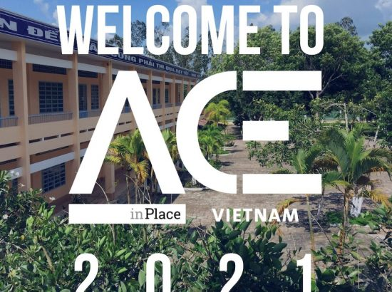 school building behind ACE in Place Vietnam welcome logo