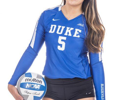 female headshot wearing blue duke volleyball uniform holding volleyball