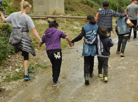 group of women holding hands walking down street